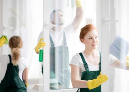Canva---Team-cleaning-office-windows-(1)